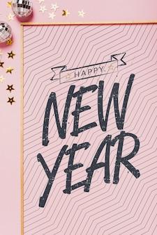 Vista superior letras de año nuevo con marco simple