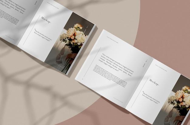 Vista superior de libro abierto con maqueta de revista editorial de sombras