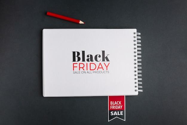 Vista superior de la maqueta del concepto de viernes negro sobre fondo negro