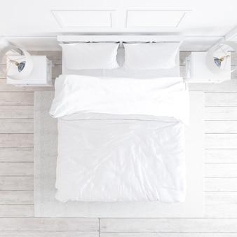 Vista superior de la maqueta de dormitorio blanco con elementos decorativos.