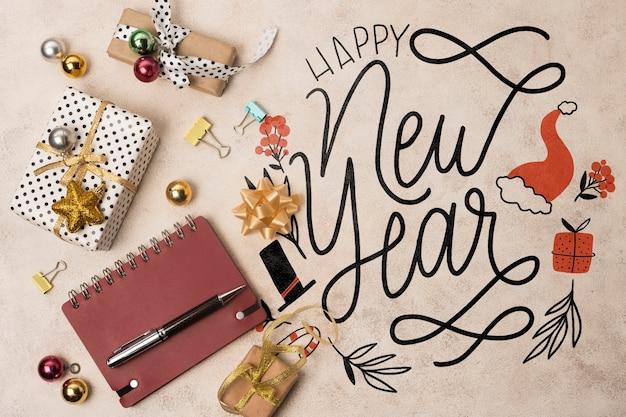 Vista superior de la maqueta de feliz año nuevo
