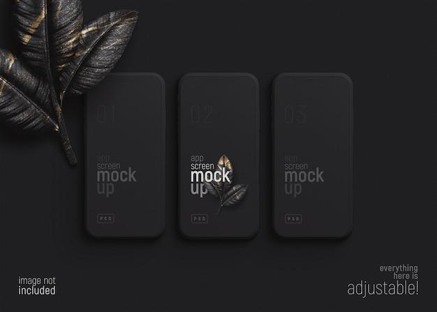 Vista superior de la maqueta de la pantalla de la aplicación de teléfono inteligente con hojas de tres dispositivos