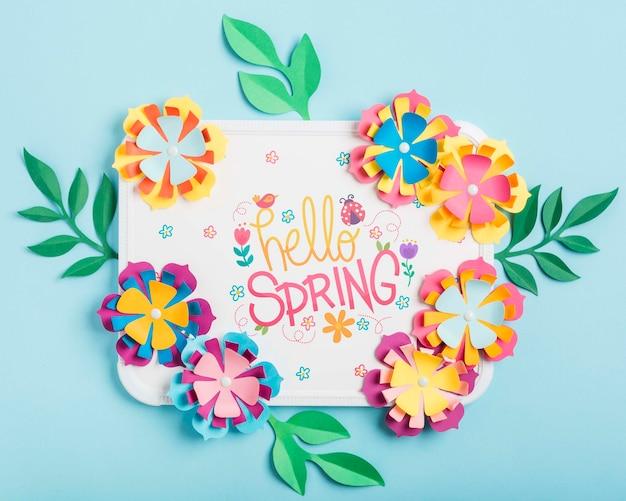 Vista superior marco de letras hola primavera