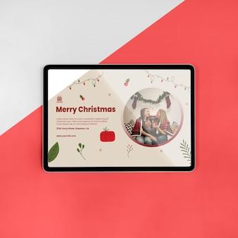 Vista superior saludo de feliz navidad con maqueta