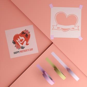 Vista superior tarjeta del día de la madre y cinta con maqueta