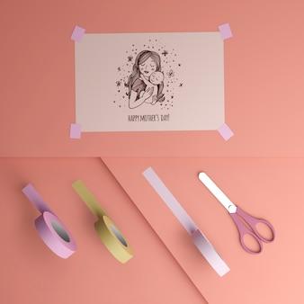 Vista superior tarjeta del día de la madre y cinta con tijeras