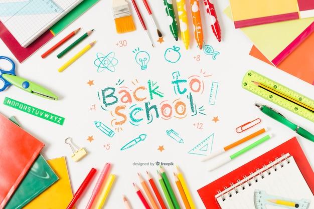 Vista superior de útiles escolares con dibujo