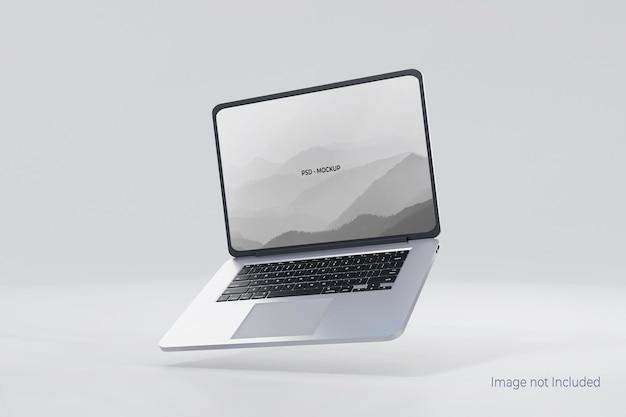 Vliegende laptop mockup ontwerp geïsoleerd op grijs