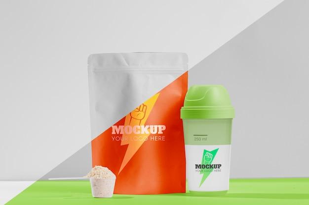 Vooraanzicht oranje proteïne en shaker