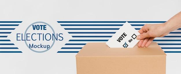 Votación para maqueta de elecciones con mano