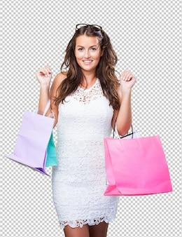 Vrij jonge vrouw met het winkelen zakken