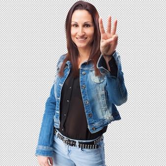 Vrouw die een nummer drie gebaar doet