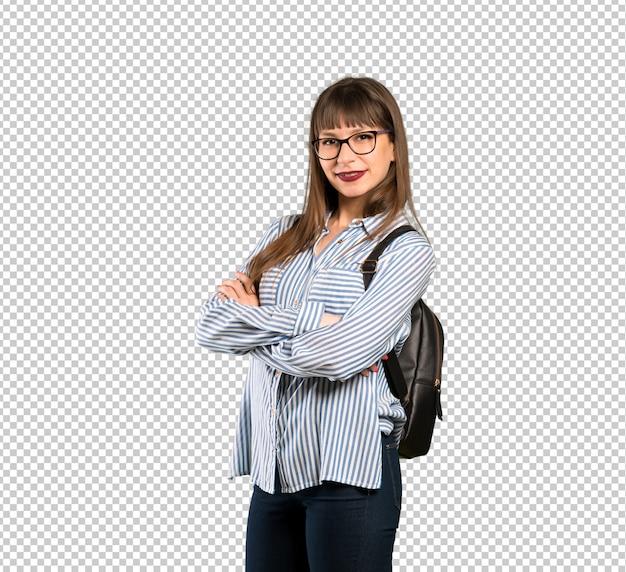 Vrouw met een bril met armen gekruist en kijkt uit