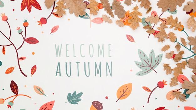 Welkom herfst belettering met bladeren op effen achtergrond