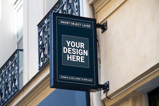 Winkel merk uithangbord mockup