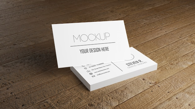 Wit adreskaartjemodel die op houten lijst stapelen.