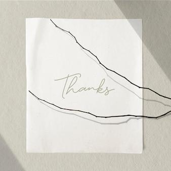 Wit papier met gedroogde twijgen op een betonnen muurmodel