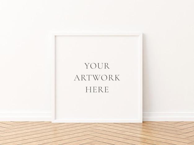 Wit vierkant framemodel op de houten vloer. 3d-rendering.
