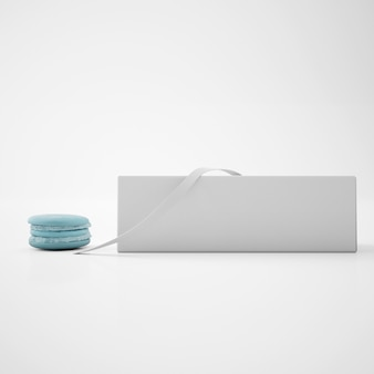 Witte doos met lint en blauwe macaron