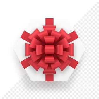 Witte zeshoekige geschenkdoos en rode strik bovenaanzicht