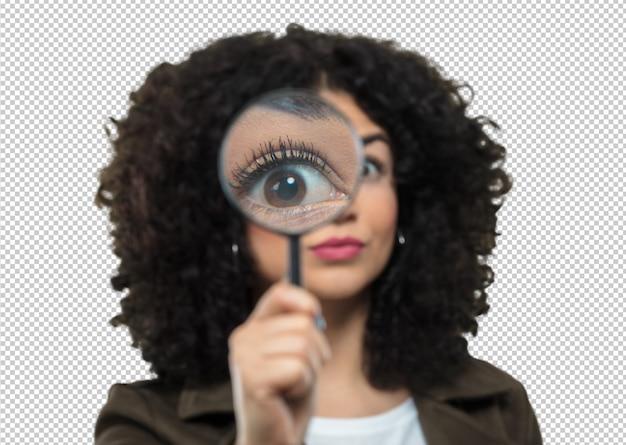Youn donna in possesso di una lente d'ingrandimento
