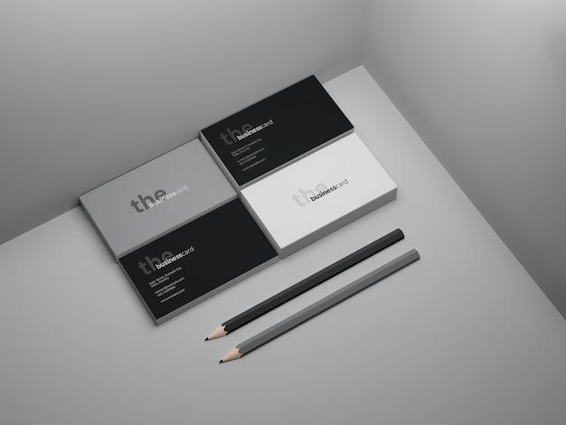 Zakelijk visitekaartje mockup met twee potloden