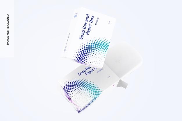 Zeepstaaf en papieren dozen mockup drijvend