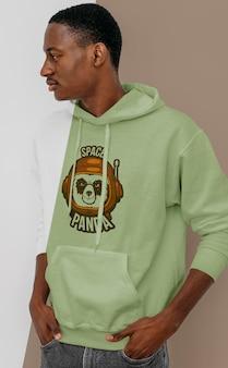 Zijaanzicht van stijlvolle man in hoodie