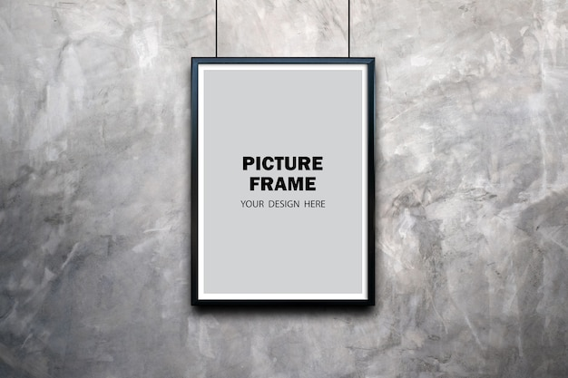 Zwart fotolijstmodel op betonnen kamermuur