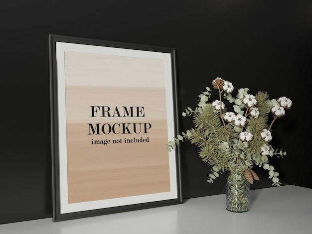 Zwart frame mockup naast bloemen