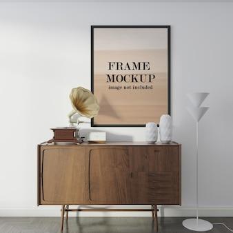 Zwart frame mockup naast grammofoon
