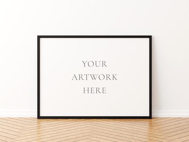 Zwart horizontaal framemodel op de houten vloer. 3d-rendering.