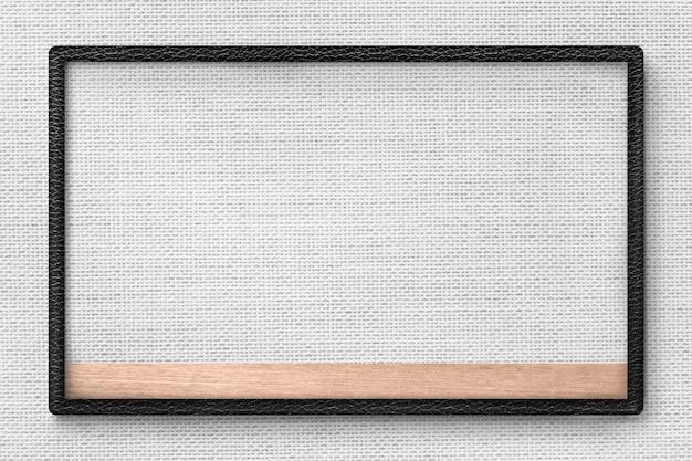 Zwart lederen frame op grijze stof textuur achtergrond afbeelding