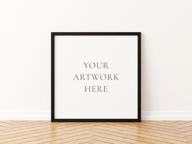 Zwart vierkant framemodel op de houten vloer. 3d-rendering.