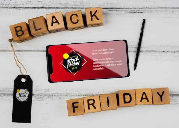 Zwart vrijdag concept met mock-up smartphone