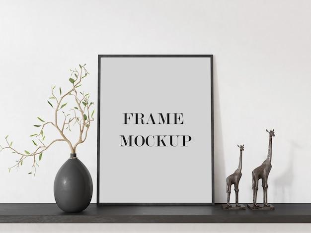Zwarte fotolijst naast giraffen 3d-rendering mockup