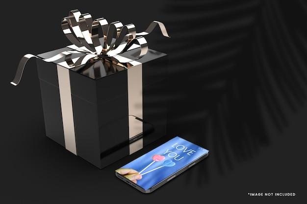 Zwarte kleur luxe geschenkdoos mockup met smartphone