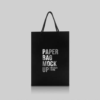 Zwarte papieren zak met handvatten mockup