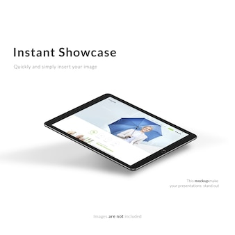 Zwarte tablet op witte achtergrond bespotten