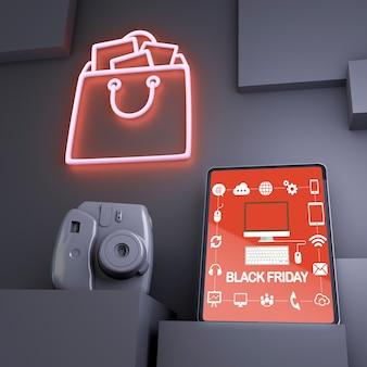 Zwarte vrijdagachtergrond met tabletmodel en rode neonlichten
