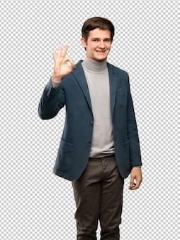 Adolescent, col roulé, montrer signe ok, à, doigts