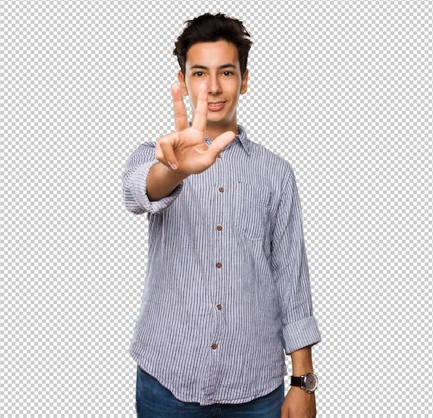 Adolescent faisant le geste numéro trois