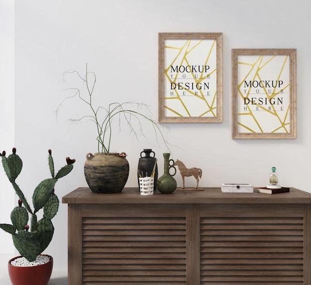 Affiche de maquette avec cadre sur table d'armoire avec décoration