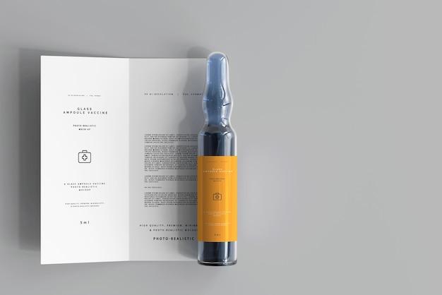 Ampoule en verre avec maquette de brochure à deux volets