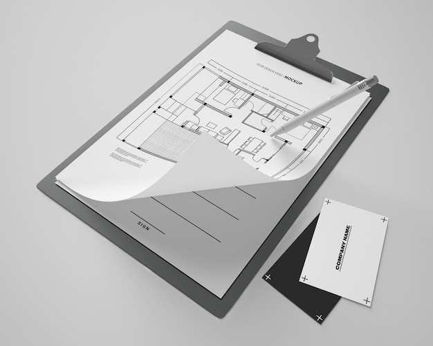 Angle élevé de la maquette du bloc-notes avec des cartes et un stylo