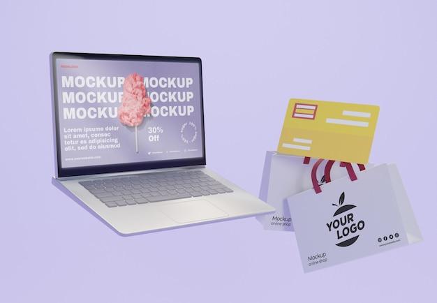 Arrangement commercial créatif avec maquette d'ordinateur portable