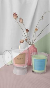 Arrangement créatif d'emballages de bougies maquette