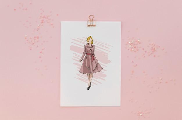 Arrangement plat avec carte maquette sur fond rose
