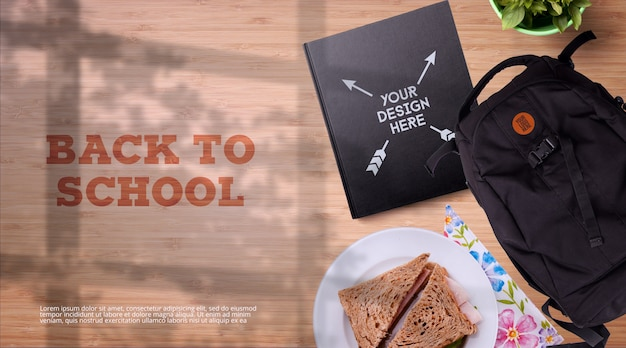 Back to school mockup notebook & backpack on wooden table background