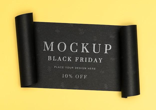 Bannière roulée de maquette de vente vendredi noir fond jaune